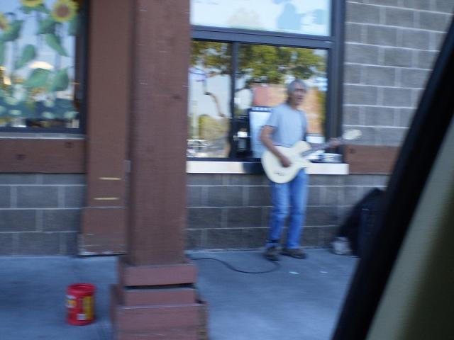 Passing Guitarist